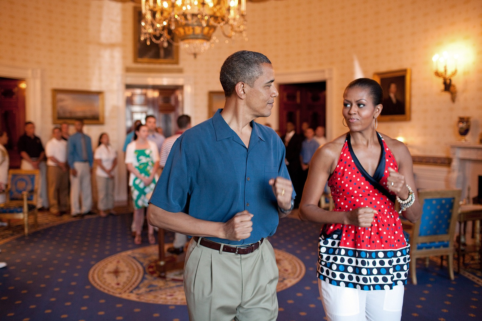 President Barack Obama and First Lady Michelle Obama pretend to march to music in the Blue Room of the White House, July 4, 2010, before delivering remarks to military families during a Fourth of July celebration. (Official White House Photo by Pete Souza) This official White House photograph is being made available only for publication by news organizations and/or for personal use printing by the subject(s) of the photograph. The photograph may not be manipulated in any way and may not be used in commercial or political materials, advertisements, emails, products, promotions that in any way suggests approval or endorsement of the President, the First Family, or the White House.